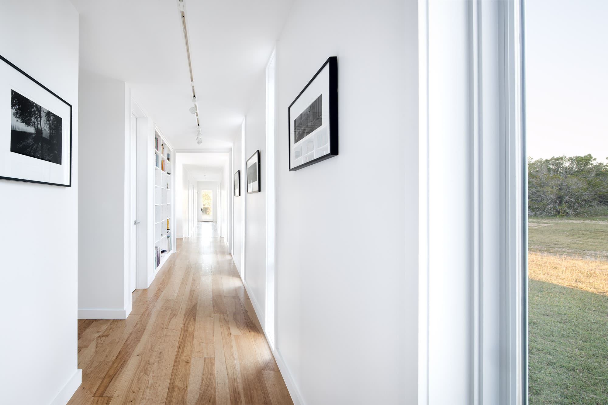 Bright airy hallway of Self-sustaining home in Wimberley Texas