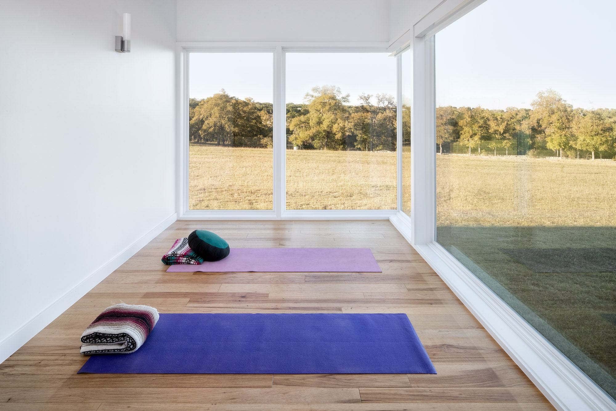 Yoga or meditation room with large windows Self-sustaining home in Wimberley Texas