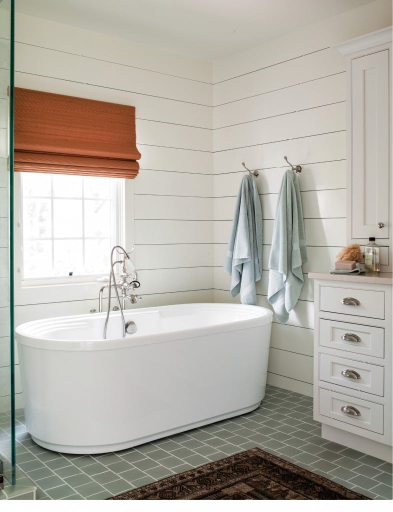 """Shiplap walls add texture and character to a brand-new bathroom. Soaking tubs are not only incredibly relaxing, but they also add a sculptural element to a space. I often have square tiles laid in a subway pattern for added subtle interest."""