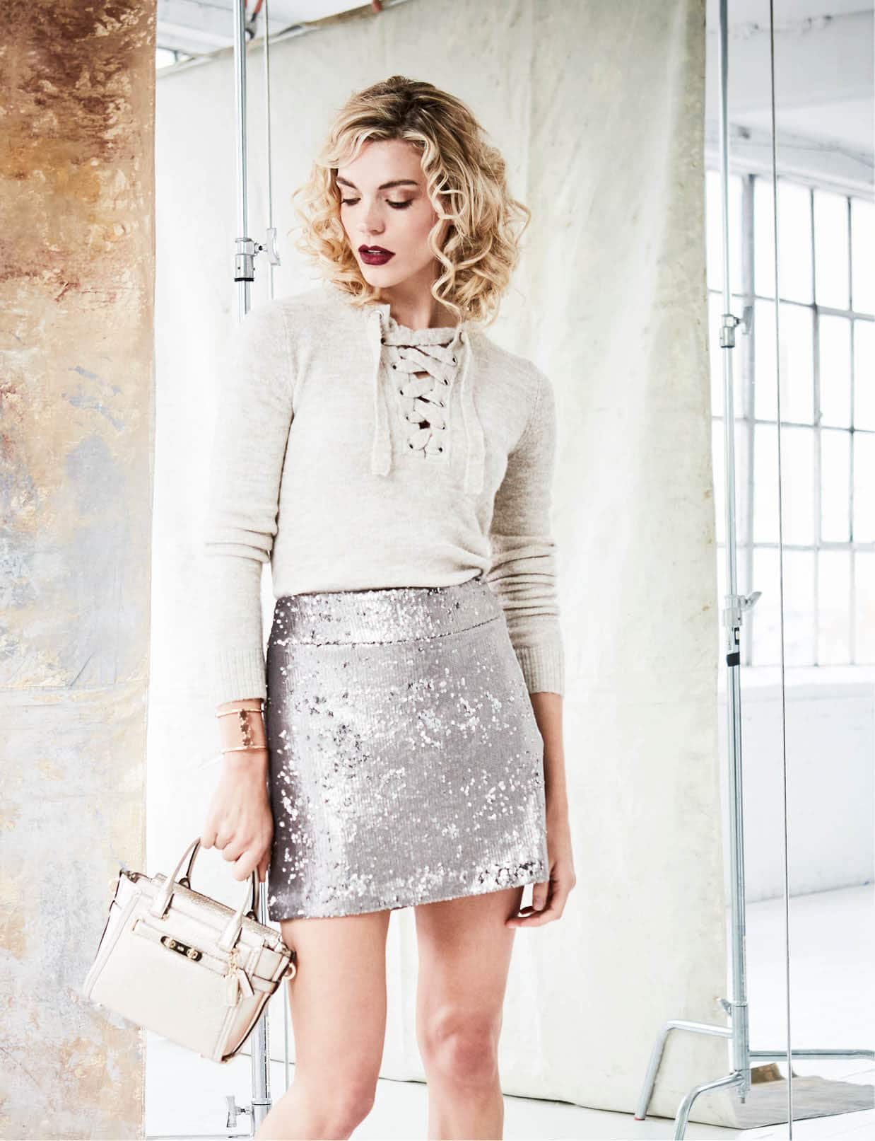 Kensic sweater, $79, Macy's. Halston sequin skirt, $245, Tootsies. Vince Camuto bracelet, $78, Belk. Coach bag, $350, Belk.