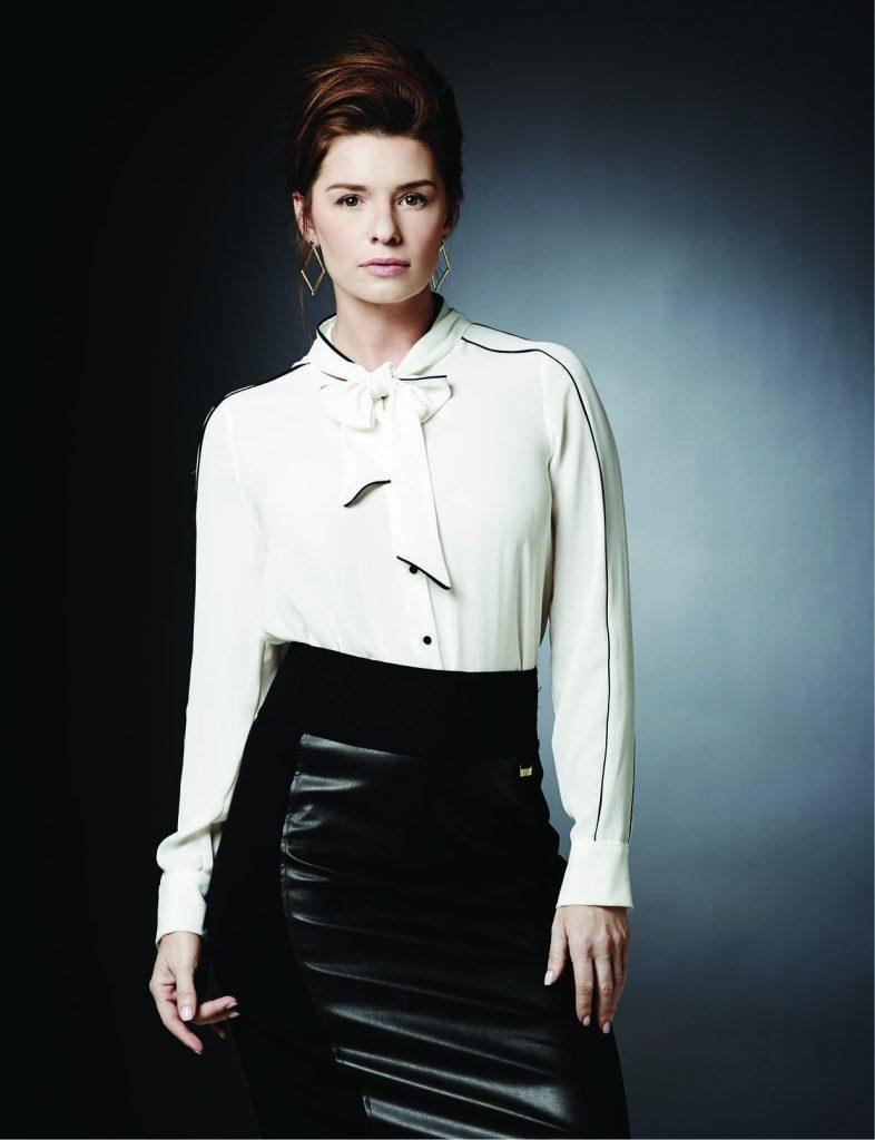 Tie-up blouse, $39: Zara. Calvin Klein faux leather skirt, $59.50: Belk. Trina Turk earrings, $54: Belk.