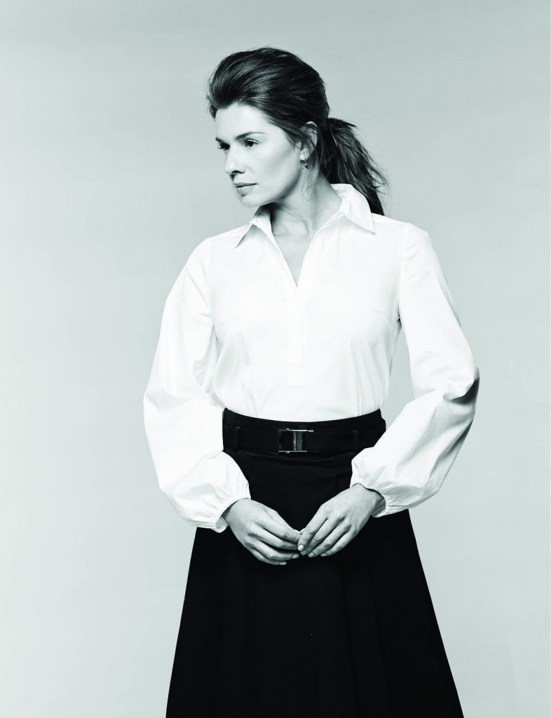 Drama Sleeve poplin shirt, $88: White House Black Market. Belted stretch cotton skirt, $150: Michael Kors North Park Center. Trina Turk earrings, $40: Belk.