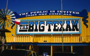 The Big Texan exterior, Billy Hathorn|Wikipedia.org, CC BY-SA 3.0. Interior, Valerie Everett|Flickr.com/people/66742614@N00, CC BY 2.0.