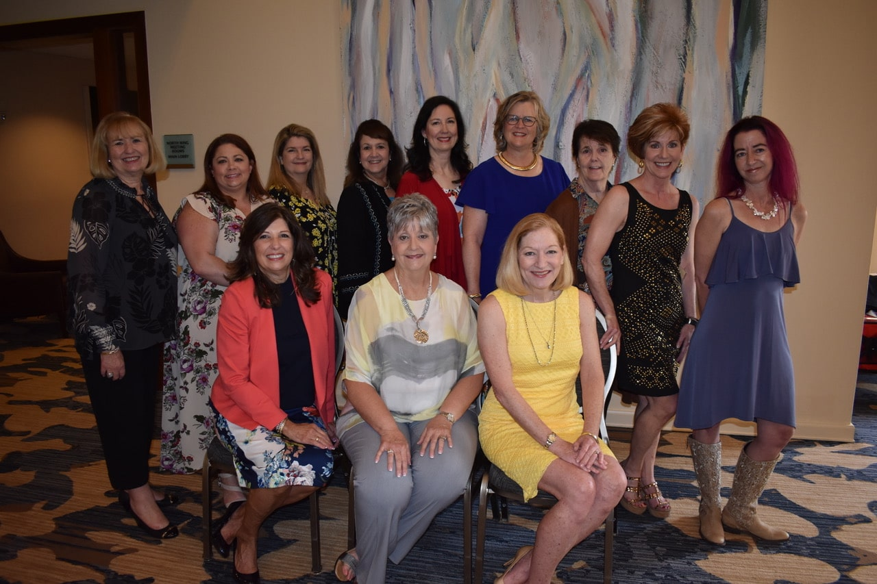 Cypress-Woodlands Junior Forum president Carol Brushwood was recently honored by new president Renee Atkinson for her work