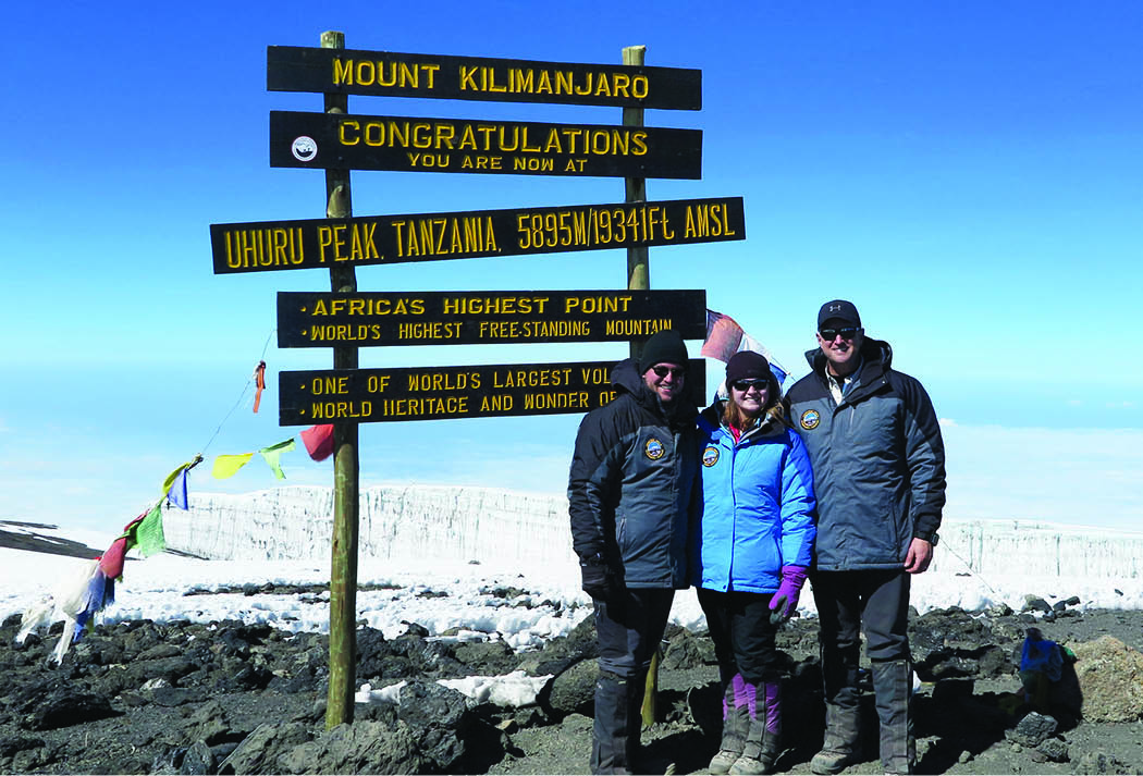 Dr. Michael Fisher and his children Landon and Monica atop the 19,341 ft. summit of Africa's Mount Kilimanjaro