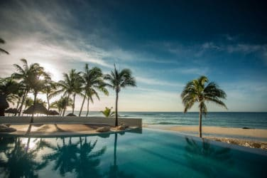 retreat to the sandy shores of Playa del Carmen