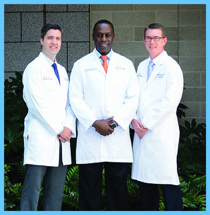 Pictured L TO R: David Garrigues, MD, Leonard Kibuule, MD, and Anthony Berg, MD