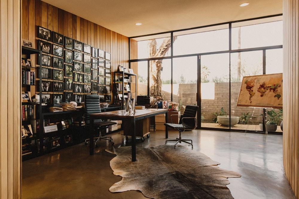home office mid-century modern home studio desk wood rug natural lighting