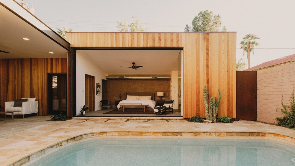 mid century modern master bedroom overlooking pool